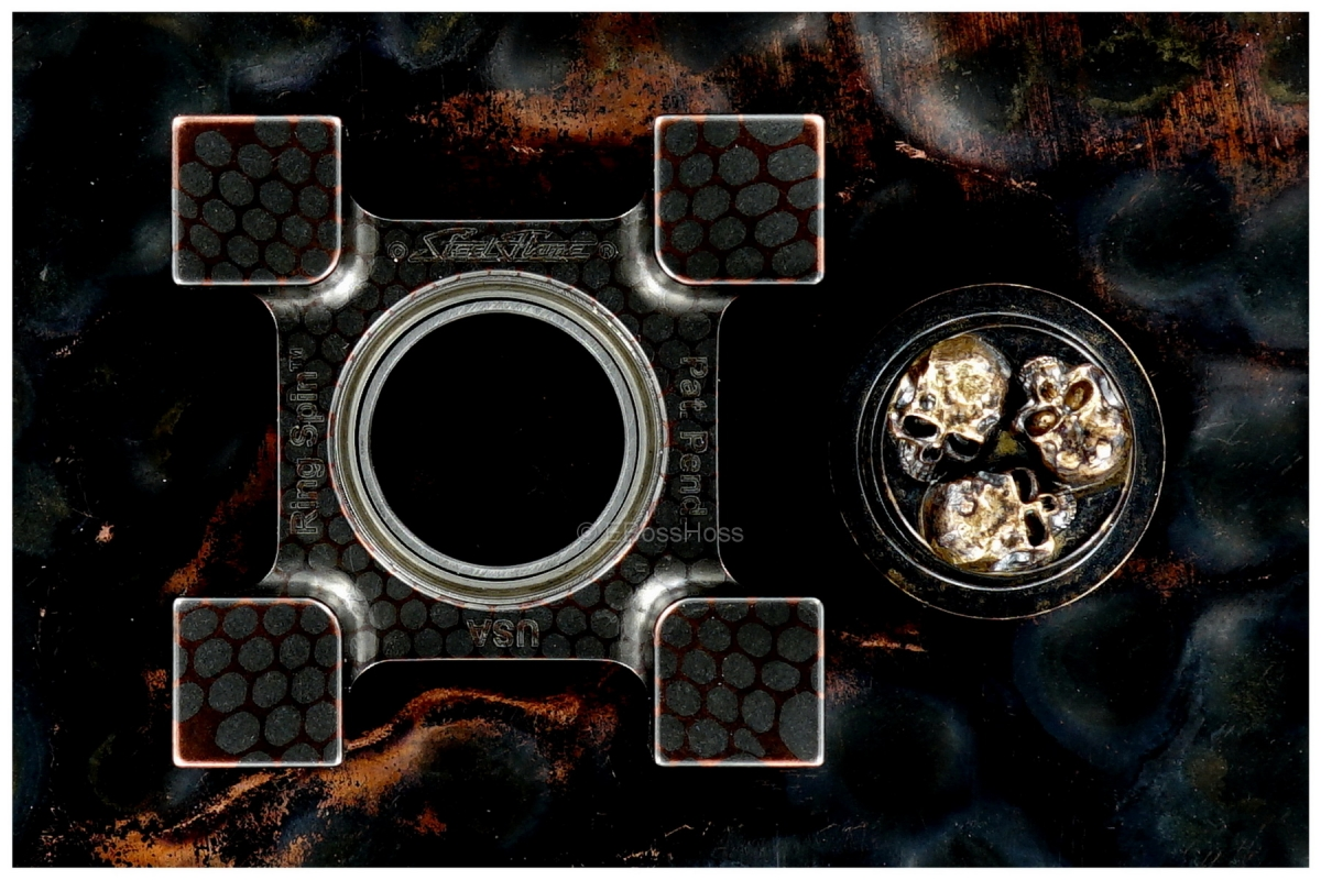 Steel Flame Deluxe Super-Conductor XL Ring Spin with Pile of Skulls Plug