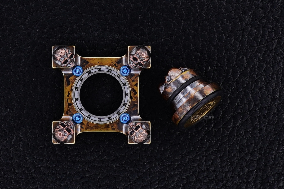 Steel Flame 3-D Copper Pile of Skulls Ring Spin KillBoX